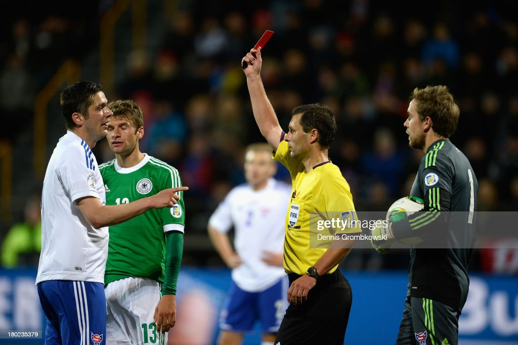 Atli Gregersen of Faeroe Islands is shown the red card by referee Gediminas Mazeika during the FIFA 2014 World Cup Qualifier match between Faeroe Islands and Germany on September 10, 2013 in Torshavn, Denmark.
