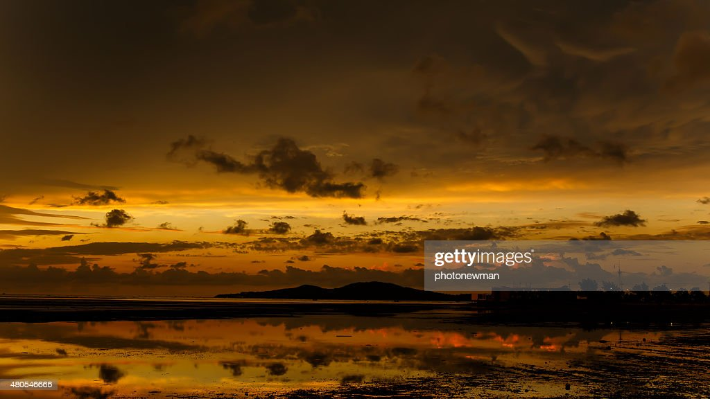atmosphere at sunrise on the beach : Stock Photo