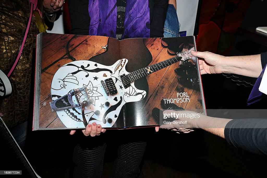 Atmosphere at the book launch and performance for '108 Rock Star Guitars' benefitting The Les Paul Foundation at The Cutting Room on October 8, 2013 in New York City.