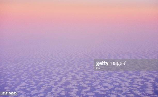 Atmospheric elevated view above the clouds