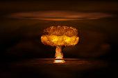 Atomic bomb realistic explosion, orange color with smoke on black background