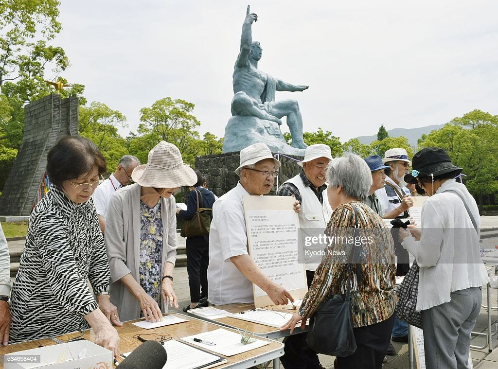 Atomic bomb survivors in the southwestern Japan city of Nagasaki collect signatures on May 27, 2016, as part of a campaign to promote the dismantling of nuclear arsenals, the same day U.S. President Barack Obama will visit Hiroshima, another atomic-bombed city. Claiming that Nagasaki should be the last a-bombed city, the survivors plan to submit the signatures to the United Nations.