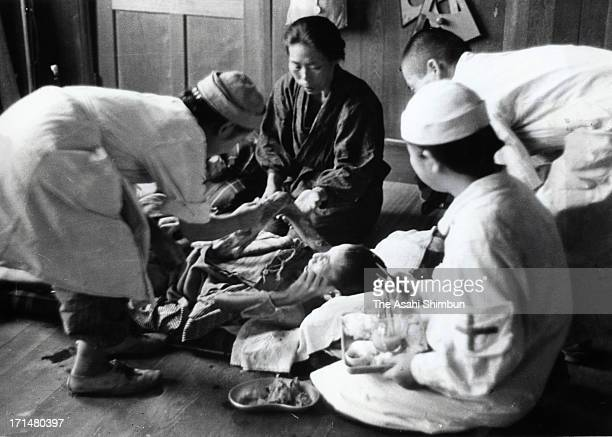 Atomic bomb survivors receive treatment at temporary hospital set at Shin Kozen Elementary School in August 1945 in Nagasaki Japan The world's first...