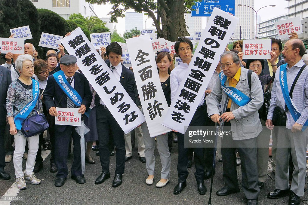Atomic bombing survivors, or hibakusha, and their supporters celebrate on June 29, 2016, after the Tokyo District Court accepted that six of them should be recognized as sufferers of A-bomb related diseases. The plaintiffs were in Hiroshima and Nagasaki when the cities were hit by atomic bombs in the latter stages of WWII, and have suffered various diseases, including heart failure and bowel cancer.