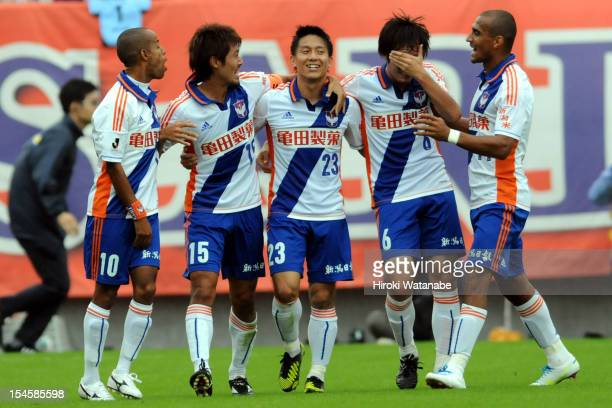 Atomu Tanaka of Albirex Niigata celebrates the first goal with his team mates Michael Jefferson Nascimento Isao Honma Yuta Mikado and Bruno Da Silva...