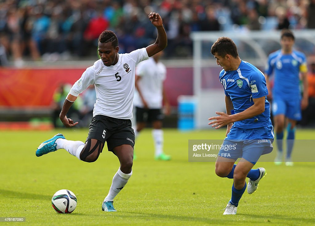 Atonio Tuivuna of Fiji takes on Otabek Shukurov of Uzbekistan during the FIFA U-20 World Cup Group F match between Fiji and Uzbekistan at the Northland Events Centre on June 7, 2015 in Whangarei, New Zealand.