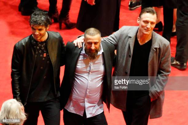 Ator Nik Xhelilaj actor Kida Khodr Ramadan and actor Oliver Masucci attend the closing ceremony of the 67th Berlinale International Film Festival at...