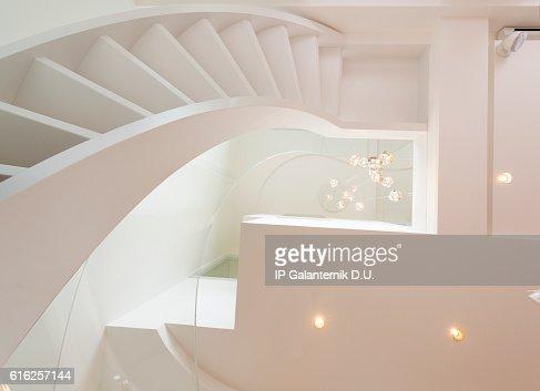 Atrium white interior with spiral staircase : Stock Photo