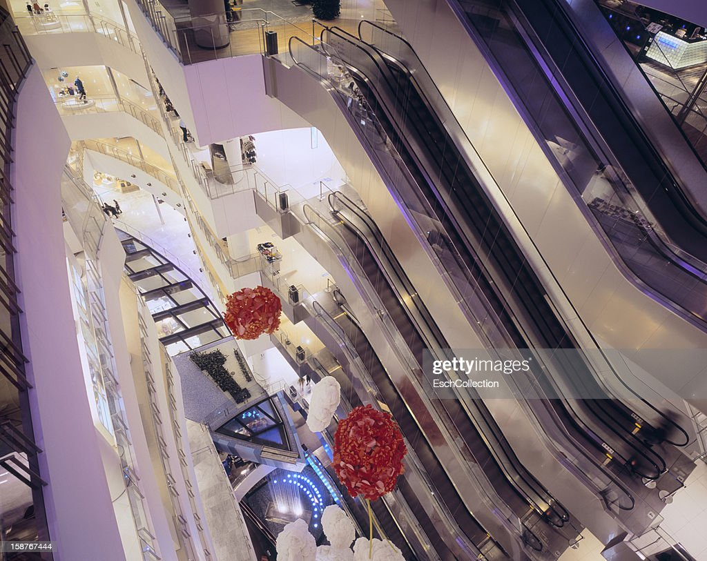 Atrium with escalators at the Cube shopping mall : Stock Photo