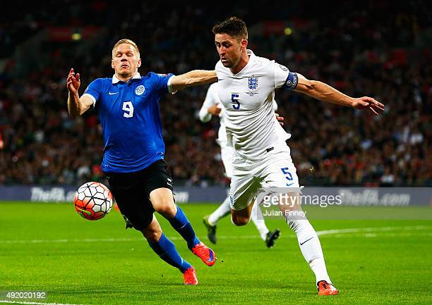 Ats Purje of Estonia and Gary Cahill of England challenge for the ball during the UEFA EURO 2016 Group E qualifying match between England and Estonia...