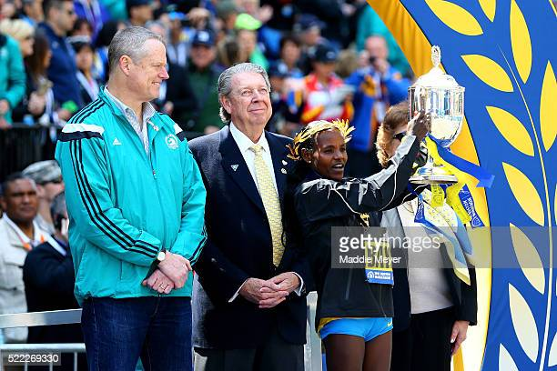 Atsede Baysa of Ethiopa celebrates after crossing the finish line to win the 120th Boston Marathon as Massachusetts governor Charlie Baker looks on...