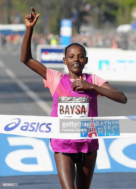 Atsede Baysa of Ethiopia crosses the finish line to win the 34th Paris Marathon on April 11 2010 in Paris France