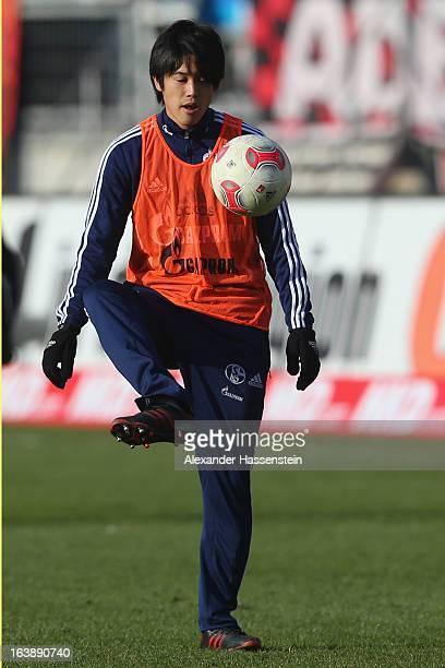 Atsudo Uchida of Schalke warms up prior the Bundesliga match between 1 FC Nuernberg and FC Schalke 04 at GrundigStadion on March 16 2013 in Nuremberg...