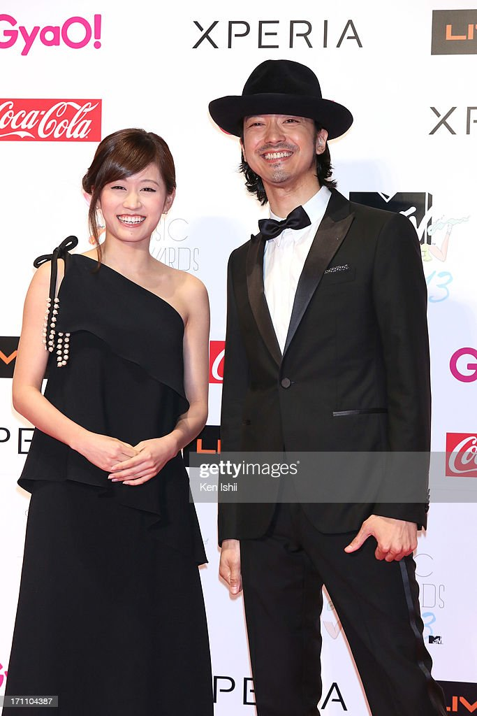 <a gi-track='captionPersonalityLinkClicked' href=/galleries/search?phrase=Atsuko+Maeda&family=editorial&specificpeople=6867932 ng-click='$event.stopPropagation()'>Atsuko Maeda</a> (L) and Nobuaki Kaneko pose for photos during MTV VMAJ 2013 at Makuhari Messe on June 22, 2013 in Chiba, Japan.