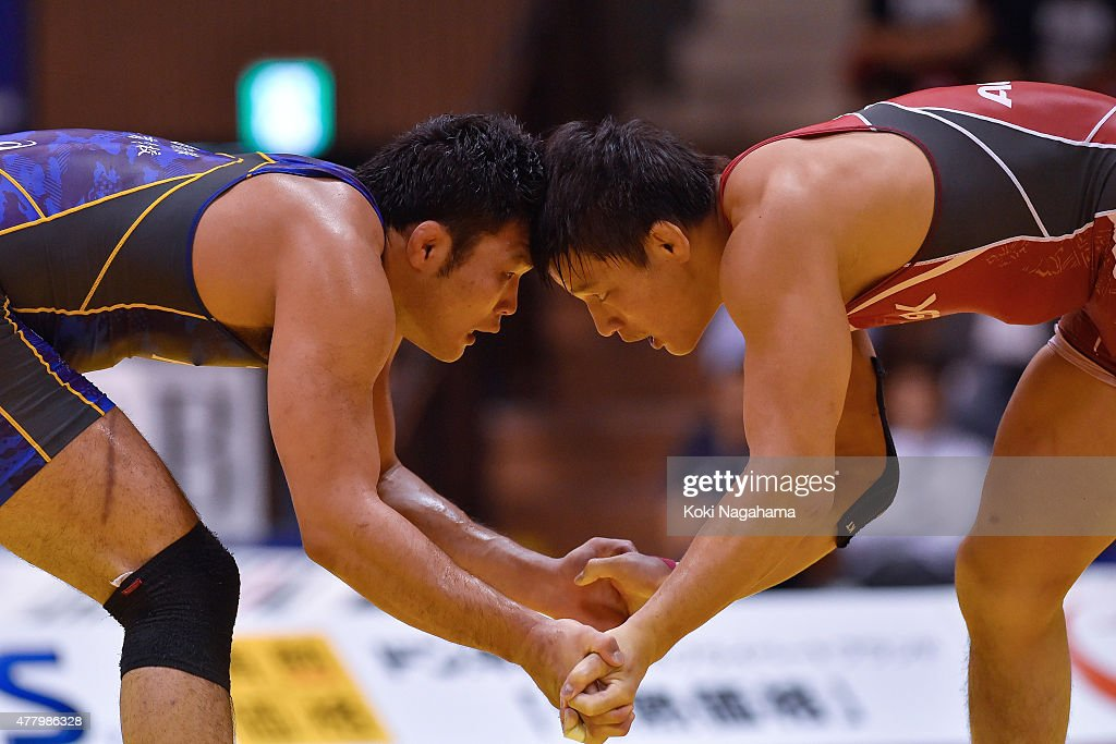 Atsushi Matsumoto (red) competes in the Men's 86kg free style final match against Naoya Akaguma(blue) during All Japan Wrestling Championships at Yoyogi National Gymnasium on June 21, 2015 in Tokyo, Japan.