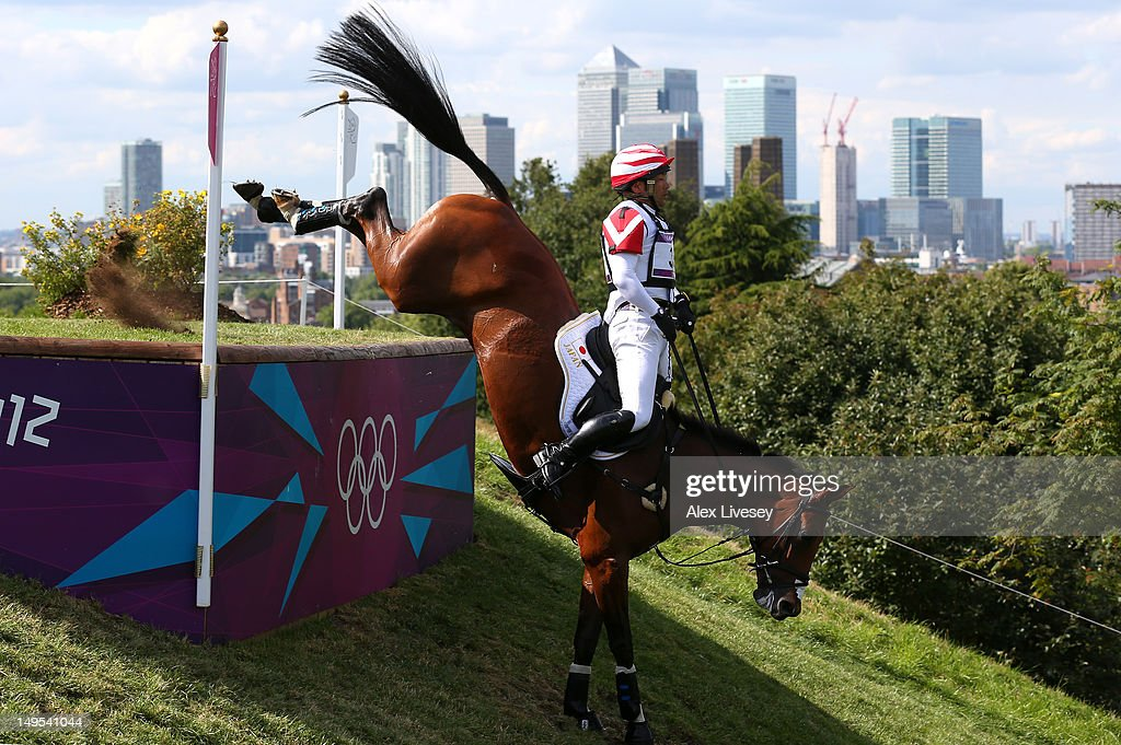 Atsushi Negishi of Japan riding Pretty Darling negotiates an obstacle in the Eventing Cross Country Equestrian event on Day 3 of the London 2012 Olympic Games at Greenwich Park on July 30, 2012 in London, England.