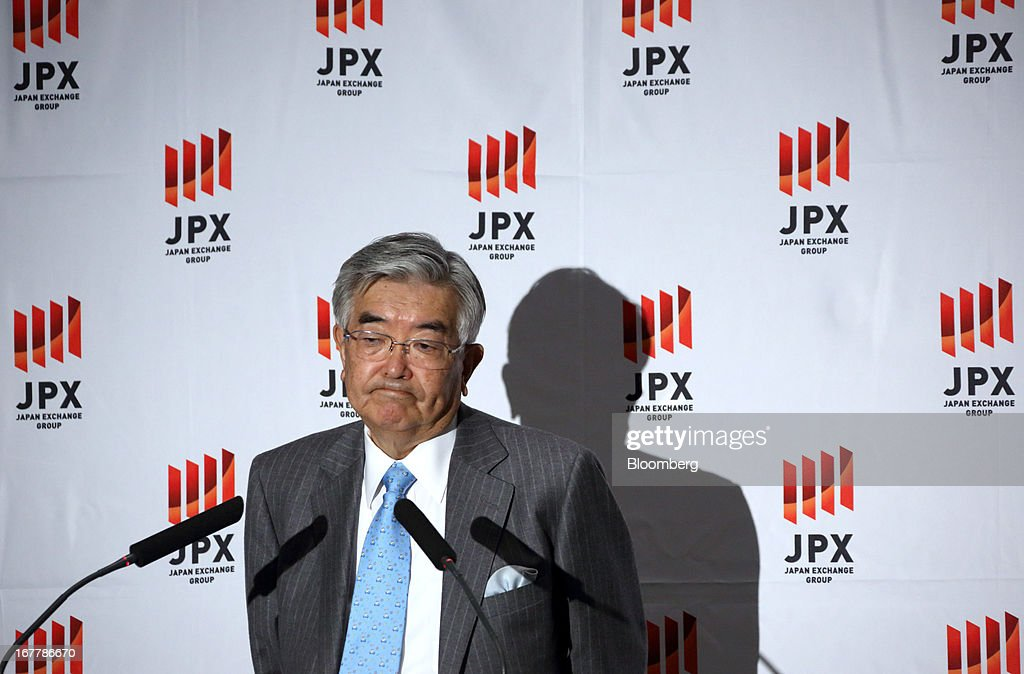 Atsushi Saito, chief executive officer of Japan Exchange Group Inc., reacts during a news conference at the Tokyo Stock Exchange in Tokyo, Japan, on Tuesday, April 30, 2013. Japan Exchange Group Inc. forecast full-year profit that was almost half of analyst estimates in its first annual earnings report after the merger of the Tokyo Stock Exchange Group Inc. and Osaka Securities Exchange Co. Photographer: Tomohiro Ohsumi/Bloomberg via Getty Images