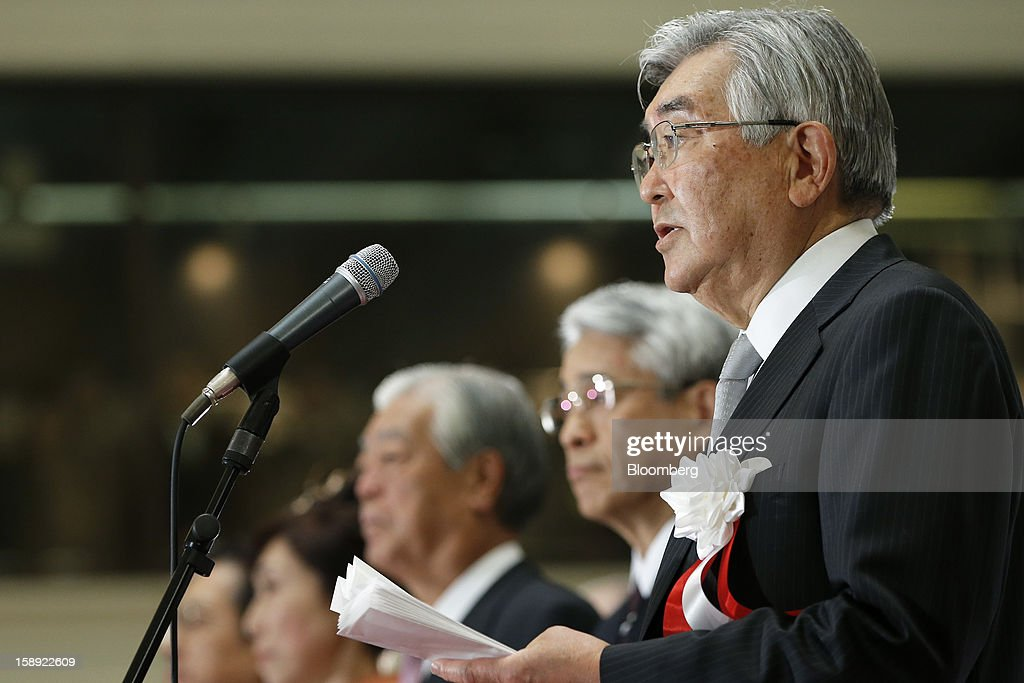Atsushi Saito, chief executive officer of Japan Exchange Group Inc., right, speaks as Michio Yoneda, chief operating officer, second right, listens during a ceremony marking the first trading day of the year at the Tokyo Stock Exchange (TSE) in Tokyo, Japan, on Friday, Jan. 4, 2013. Japan Exchange, created by the merger of Japan's two biggest bourses, fell in its trading debut on the Tokyo Stock Exchange. Photographer: Kiyoshi Ota/Bloomberg via Getty Images
