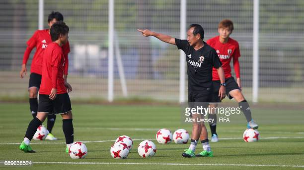 Atsushi Uchiyama the coach of Japan gives instructions during a training session at the Daejeon World Cup Stadium training pitch during the FIFA U20...