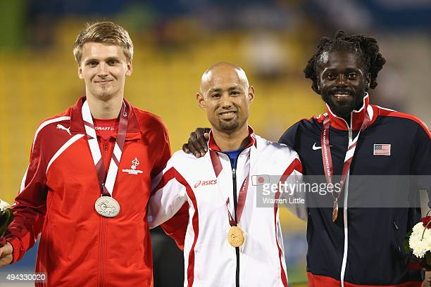 Atsushi Yamamoto of Japan poses with his gold medal Daniel Jorgensen of Denmark silver and Regas Woods of USA bronze after the men's long jump T42...