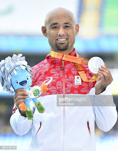 Atsushi Yamamoto of Japan poses with his silver medal in the men's T42 long jump final at the Paralympics at the Olympic Stadium in Rio de Janeiro on...