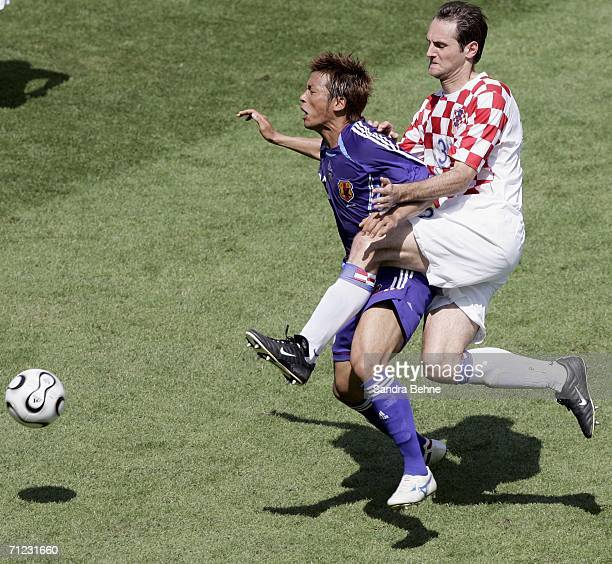 Atsushi Yanagisawa of Japan is brought down by Josip Simunic of Croatia during the FIFA World Cup Germany 2006 Group F match between Japan and...