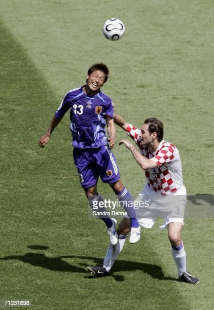 Atsushi Yanagisawa of Japan rises above Josip Simunic of Croatia to win a header during the FIFA World Cup Germany 2006 Group F match between Japan...