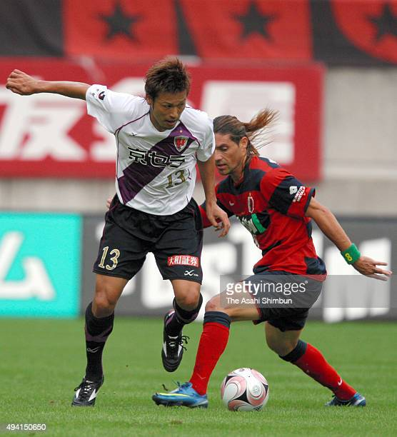 Atsushi Yanagisawa of Kyoto Sanga and Marquinhos of Kashima Antlers compete for the ball during the JLeague match between Kashima Antlers and Kyoto...