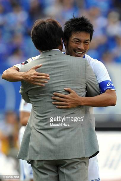 Atsushi Yanagisawa of Vegalta Sendai celebrates his goal with coach Makoto Teguramori during the JLeague match between Yokohama F Marinos and Vegalta...