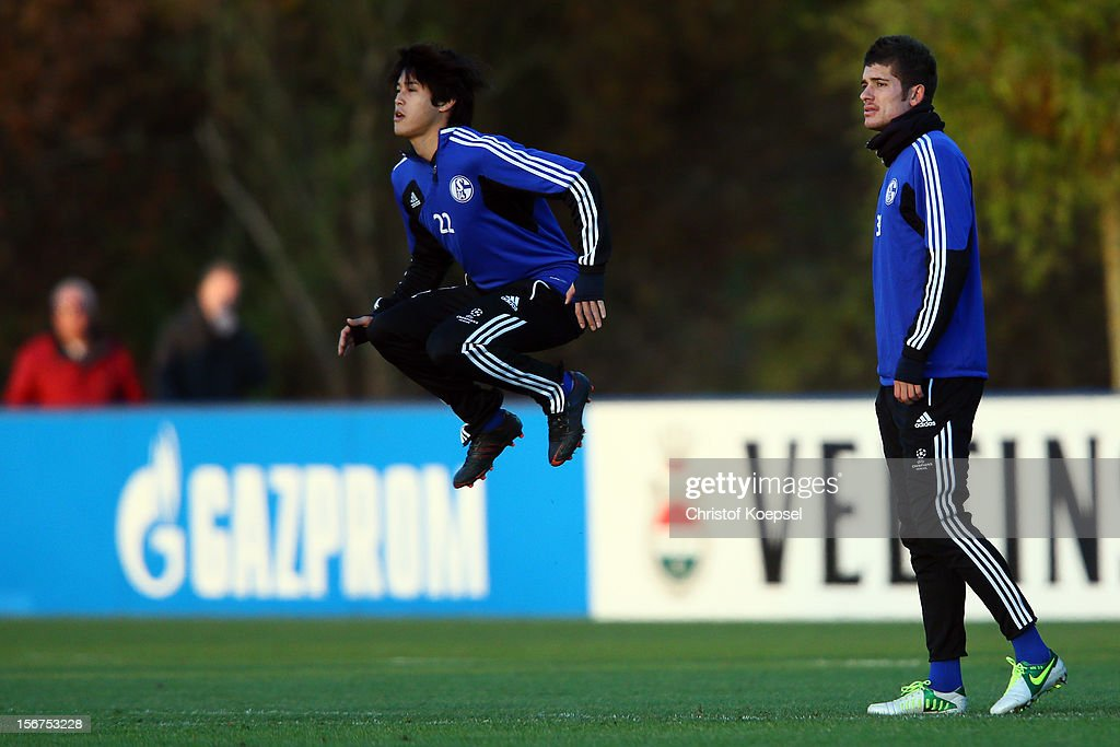Atsuto Uchida and Roman Neustaedter of Schalke 04 attend the training session at the training ground ahead of the UEFA Champions League group B match between FC Schalke 04 and Olympiakos Piraeus on November 21, 2012 in Gelsenkirchen, Germany.