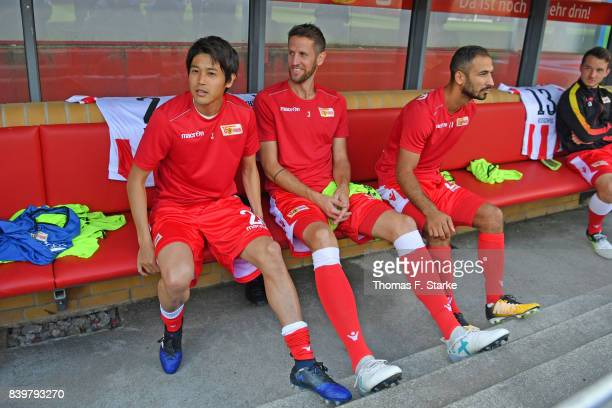 Atsuto Uchida Christoph Schoesswendter and Akaki Gogia sit on the substitutes bench prior to the Second Bundesliga match between 1 FC Union Berlin...