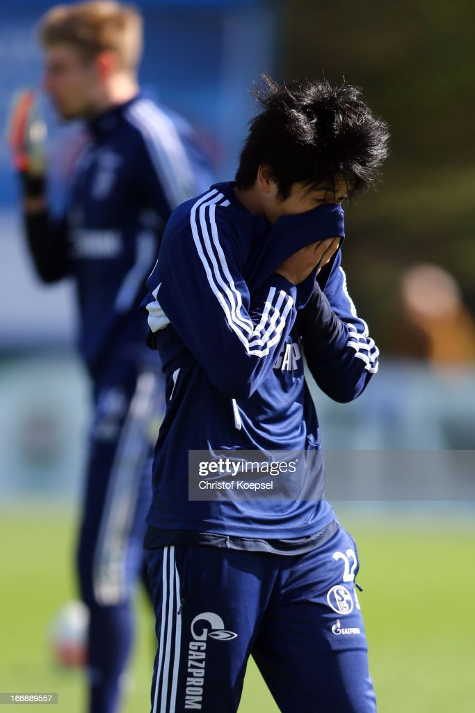 Atsuto Uchida cleans his nose during the FC Schalke 04 training session at their training ground on April 18, 2013 in Gelsenkirchen, Germany.