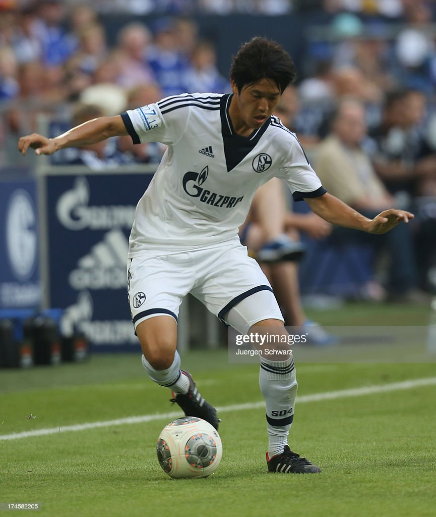 <a gi-track='captionPersonalityLinkClicked' href=/galleries/search?phrase=Atsuto+Uchida&family=editorial&specificpeople=4318608 ng-click='$event.stopPropagation()'>Atsuto Uchida</a> controls the ball during Raul's farewell match between Schalke 04 and Al-Sadd Sports Club Katar at Veltins Arena on July 27, 2013 in Gelsenkirchen, Germany.
