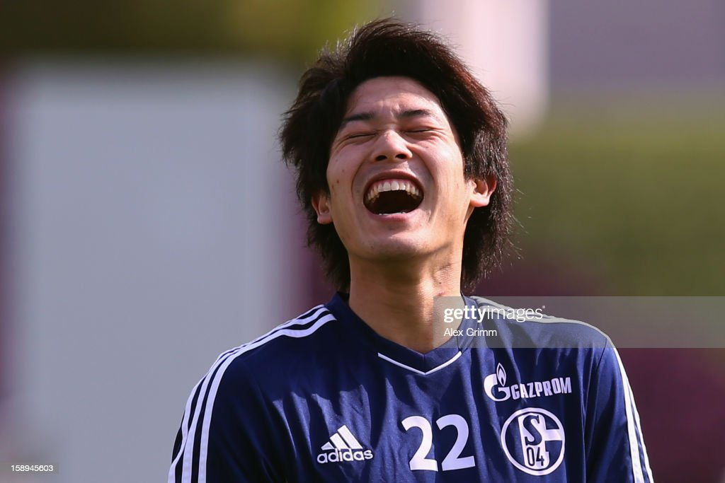 <a gi-track='captionPersonalityLinkClicked' href=/galleries/search?phrase=Atsuto+Uchida&family=editorial&specificpeople=4318608 ng-click='$event.stopPropagation()'>Atsuto Uchida</a> laughs during a Schalke 04 training session at the ASPIRE Academy for Sports Excellenc on January 4, 2013 in Doha, Qatar.
