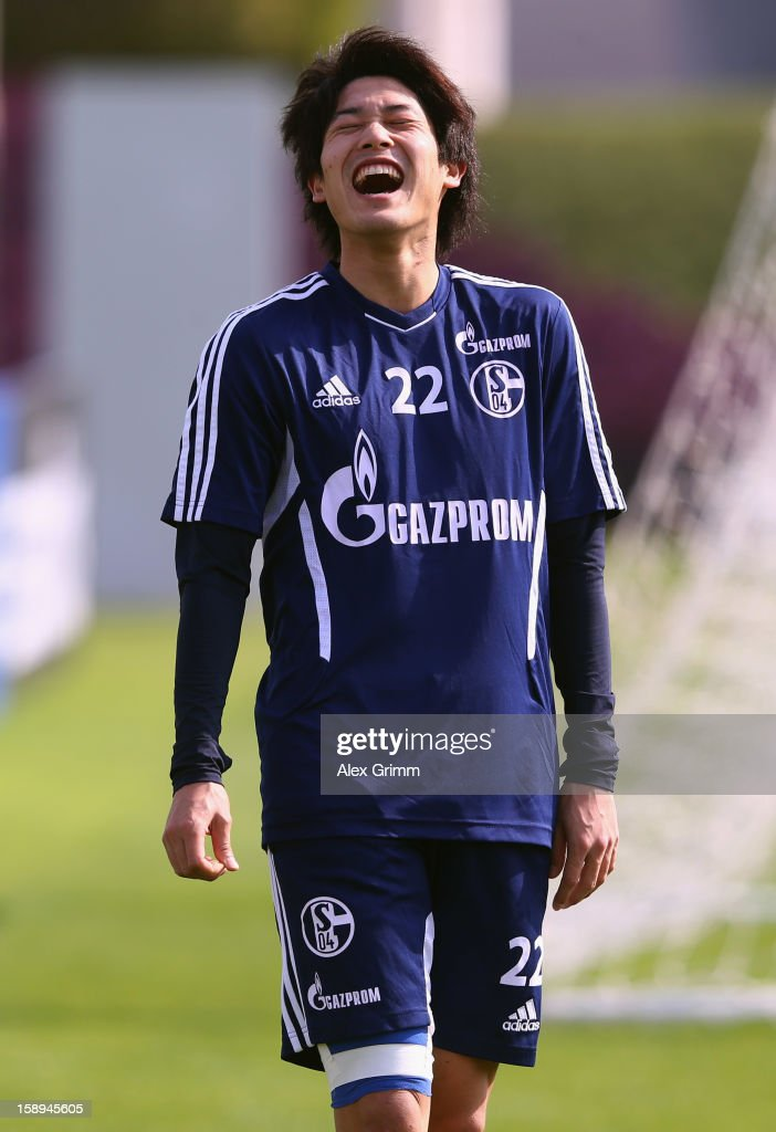 Atsuto Uchida laughs during a Schalke 04 training session at the ASPIRE Academy for Sports Excellenc on January 4, 2013 in Doha, Qatar.