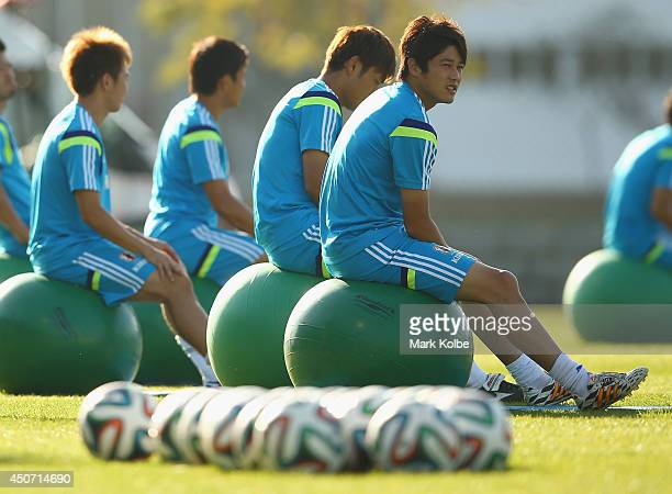 Atsuto Uchida looks on during a Japan training session at the Japan national team base camp at the Spa Sport Resort on June 16 2014 in Itu Sao Paulo