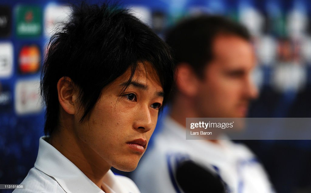 <a gi-track='captionPersonalityLinkClicked' href=/galleries/search?phrase=Atsuto+Uchida&family=editorial&specificpeople=4318608 ng-click='$event.stopPropagation()'>Atsuto Uchida</a> looks on next to team mate <a gi-track='captionPersonalityLinkClicked' href=/galleries/search?phrase=Christoph+Metzelder&family=editorial&specificpeople=463617 ng-click='$event.stopPropagation()'>Christoph Metzelder</a> during a FC Schalke 04 press conference ahead of the UEFA Champions League semifinal first leg match against Manchester United at Veltins Arena on April 25, 2011 in Gelsenkirchen, Germany.