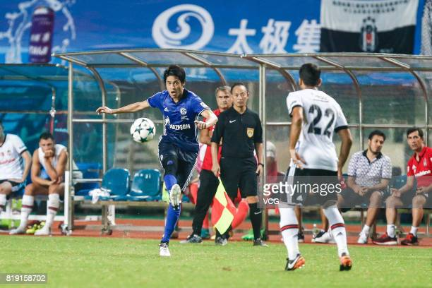 Atsuto Uchida of FC Schalke 04 and Aras Ozbiliz of Besiktas comepte for the ball during the 2017 International soccer match between Schalke 04 and...