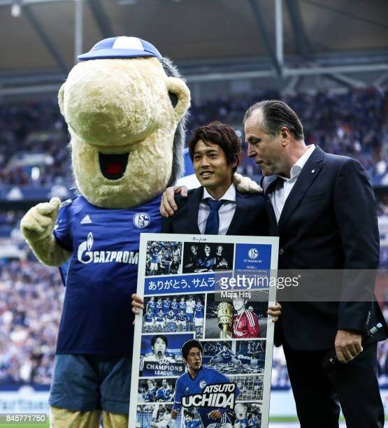 Atsuto Uchida of Japan and Clemens Toennies during goodbye ceremony prior the Bundesliga match between FC Schalke 04 and VfB Stuttgart at...