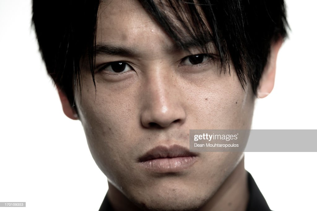 Image has been desaturated) <a gi-track='captionPersonalityLinkClicked' href=/galleries/search?phrase=Atsuto+Uchida&family=editorial&specificpeople=4318608 ng-click='$event.stopPropagation()'>Atsuto Uchida</a> of Japan and club football team Schalke 04 poses during a portrait session at Veltins-Arena on April 25, 2013 in Gelsenkirchen, Germany.