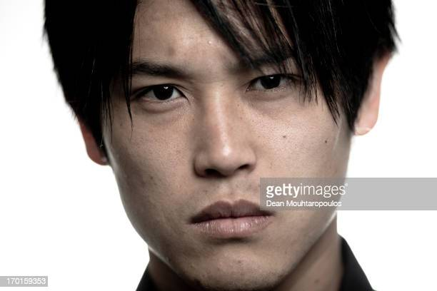 Atsuto Uchida of Japan and club football team Schalke 04 poses during a portrait session at VeltinsArena on April 25 2013 in Gelsenkirchen Germany