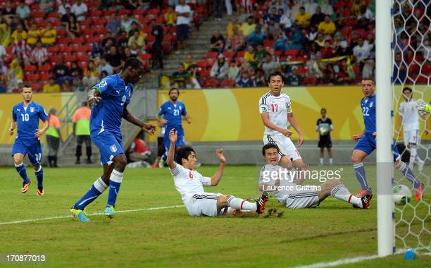 Atsuto Uchida of Japan scores an own goal during the FIFA Confederations Cup Brazil 2013 Group A match between Italy and Japan at Arena Pernambuco on...