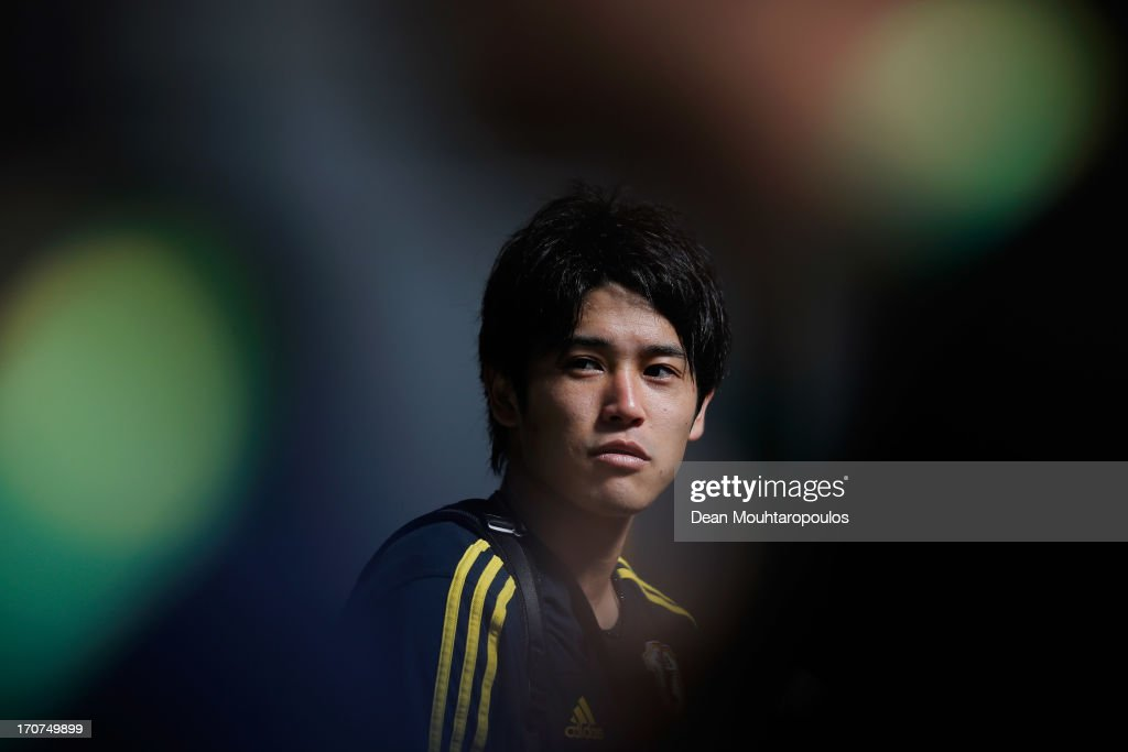 <a gi-track='captionPersonalityLinkClicked' href=/galleries/search?phrase=Atsuto+Uchida&family=editorial&specificpeople=4318608 ng-click='$event.stopPropagation()'>Atsuto Uchida</a> of Japan speaks to the media after the Japan Training Session at the Confederations Cup 2013 at Centro de Capacitacao Fisica dos Bombeiros or Training Centre for Firebrigade and Military Police on June 17, 2013 in Brasilia, Brazil.