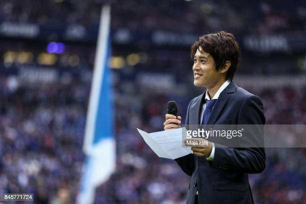 Atsuto Uchida of Japan talks to the supporters during goodbye ceremony prior the Bundesliga match between FC Schalke 04 and VfB Stuttgart at...