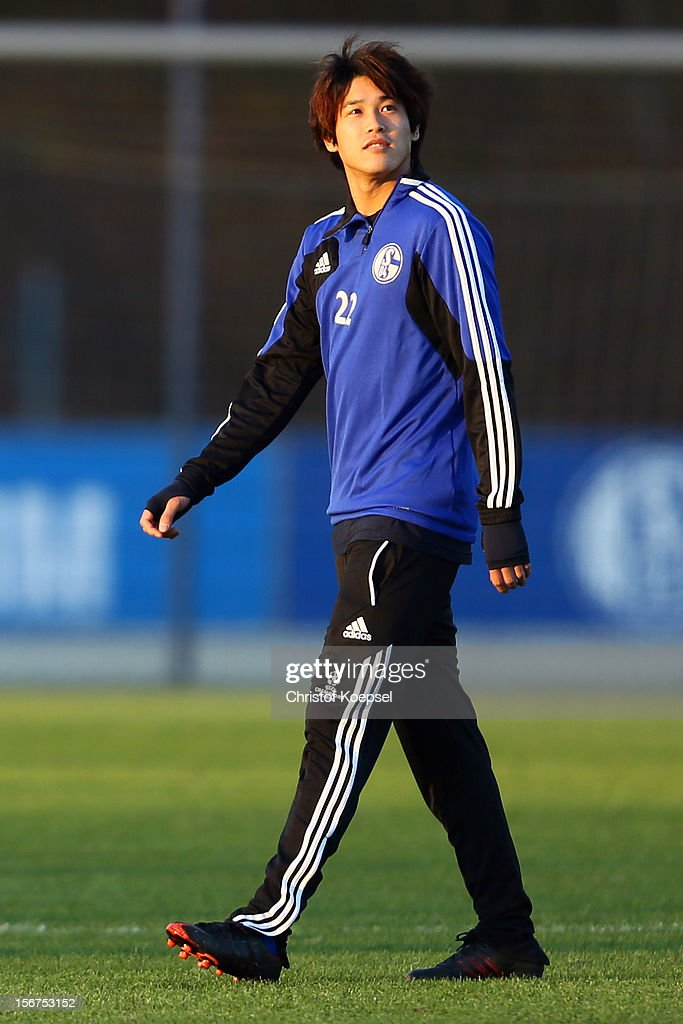 Atsuto Uchida of Schalke 04 attends the training session at the training ground ahead of the UEFA Champions League group B match between FC Schalke 04 and Olympiakos Piraeus on November 21, 2012 in Gelsenkirchen, Germany.