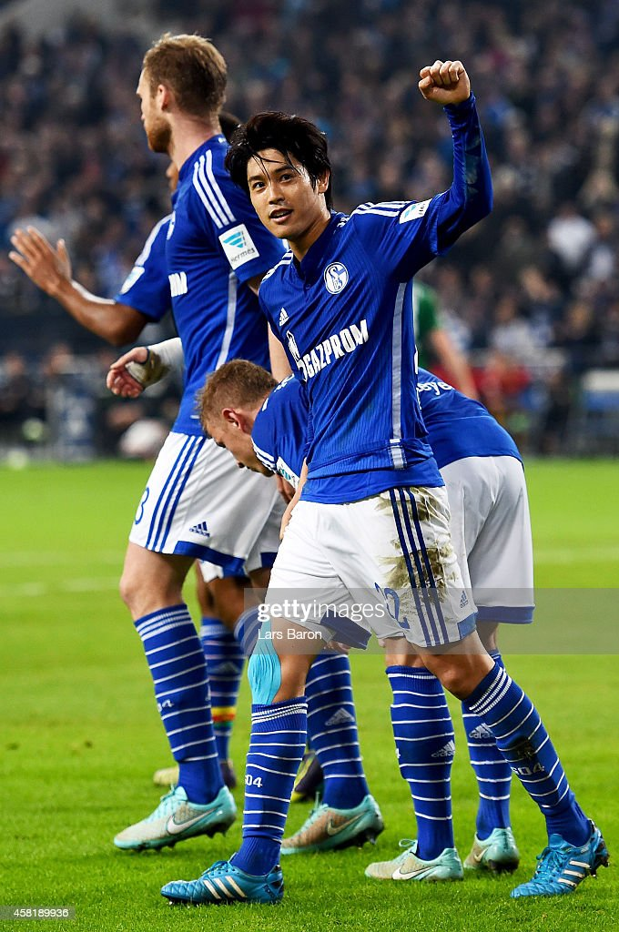 <a gi-track='captionPersonalityLinkClicked' href=/galleries/search?phrase=Atsuto+Uchida&family=editorial&specificpeople=4318608 ng-click='$event.stopPropagation()'>Atsuto Uchida</a> of Schalke 04 celebrates after team mate Klaas Jan Huntelaar scores his teams first goal during the Bundesliga match between FC Schalke 04 and FC Augsburg at Veltins Arena on October 31, 2014 in Gelsenkirchen, Germany.