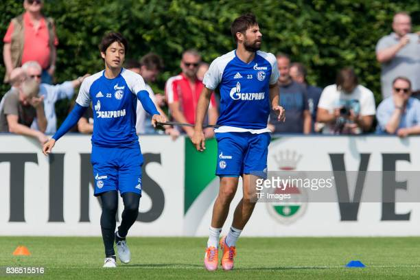 Atsuto Uchida of Schalke and Coke of Schalke during a training session at the FC Schalke 04 Training center on July 5 2017 in Gelsenkirchen Germany