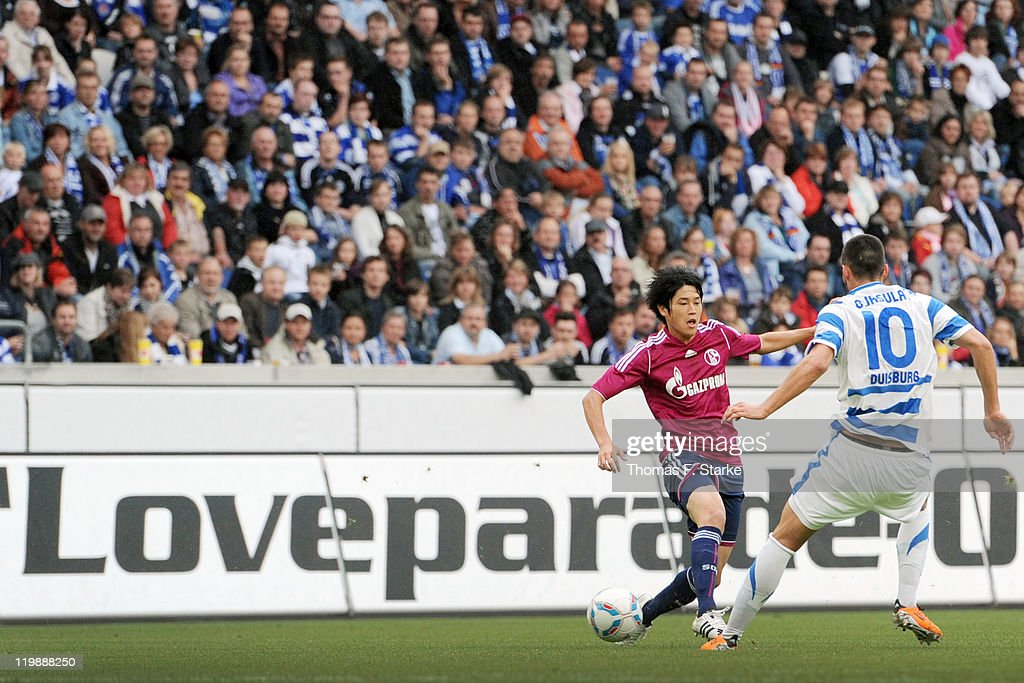 <a gi-track='captionPersonalityLinkClicked' href=/galleries/search?phrase=Atsuto+Uchida&family=editorial&specificpeople=4318608 ng-click='$event.stopPropagation()'>Atsuto Uchida</a> (L) of Schalke and Juergen Gjasula of Duisburg fight for the ball during the Loveparade charity match between MSV Duisburg and FC Schalke 04 at the Schauinsland-Reisen Arena on July 26, 2011 in Duisburg, Germany.
