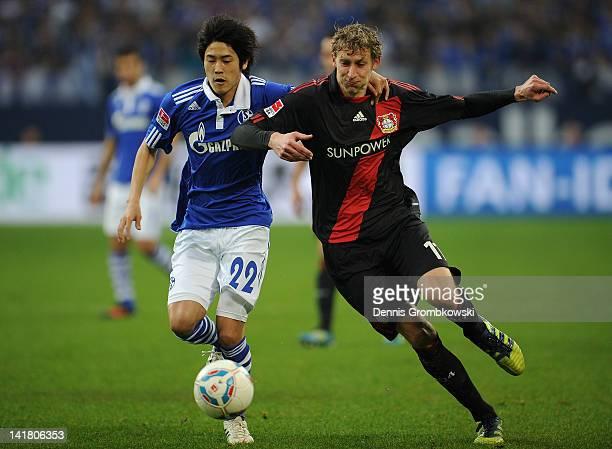 Atsuto Uchida of Schalke and Stefan Kiessling of Leverkusen battle for the ball during the Bundesliga match between FC Schalke 04 and Bayer 04...