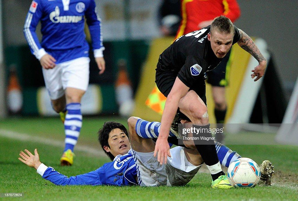 Atsuto Uchida of Schalke battles for the ball with Alexander Buettner of Arnham during the International friendly match between FC Schalke 04 and...